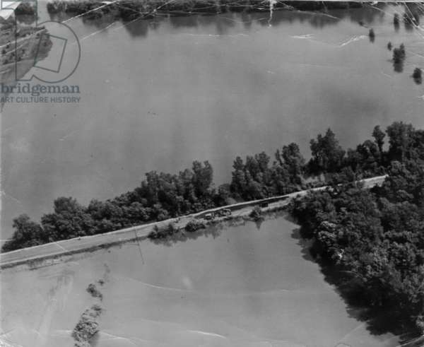 A pre-D-day American reconnaissance picture of the flooding and one of the raised exit roads from the beach, 1942 (b/w photo)