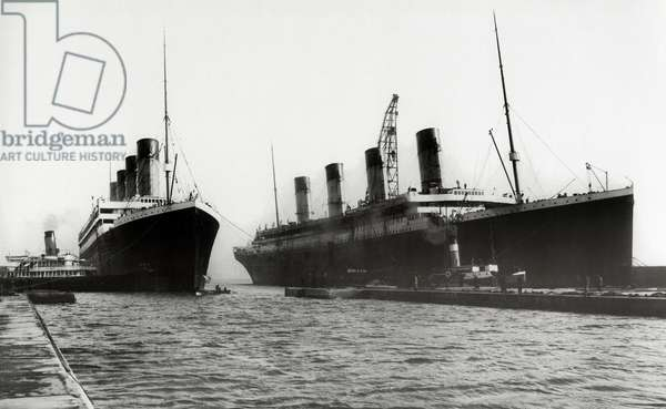 RMS Titanic and RMS Olympic, 03/02/1912. Two White Star Liners, both built by Harland & Wolff, in Belfast seen together for the last time. RMS Titanic left Southampton and Cherbourg on her maiden voyage to New York on April 10th, 1912. The steamship sank on April 15th 1912 off the coast of New Foundland after striking an iceberg during first trip with the loss of 1,635 passengers and crew. (Photo by Titanic Images/Universal Images Group) Photographie ©UIG/Leemage