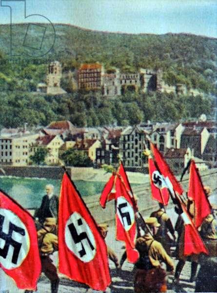 Nazi swastika flags are paraded into Heidelberg
