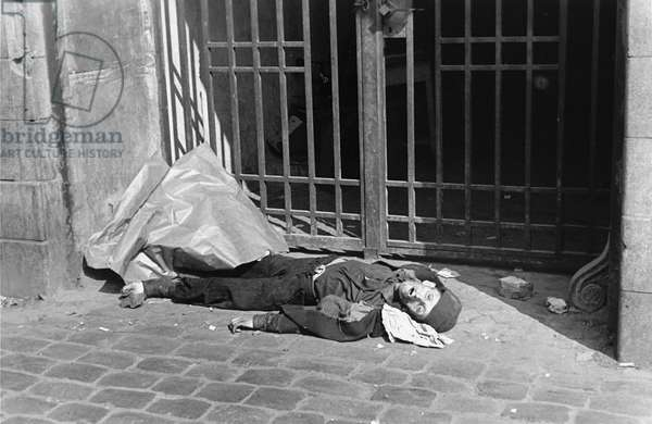 Jewish man dies of hunger on the Streets of the Warsaw Ghetto (b/w photo)