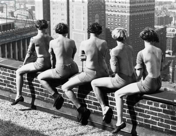 Women Sunning Themselves (b/w photo)