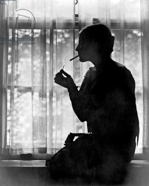 Silhouette Of A Woman Smoker (b/w photo)