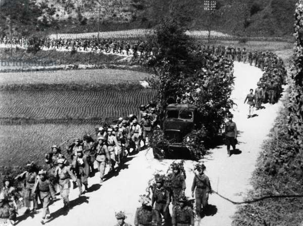 Korean War. 'On the road to the front - units of the Korean People's Army and Chinese People's Volunteers march side by side in the battle for peace and freedom.'
