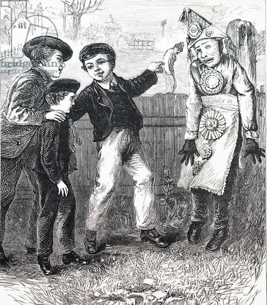 Boys making an effigy of Guy Fawkes