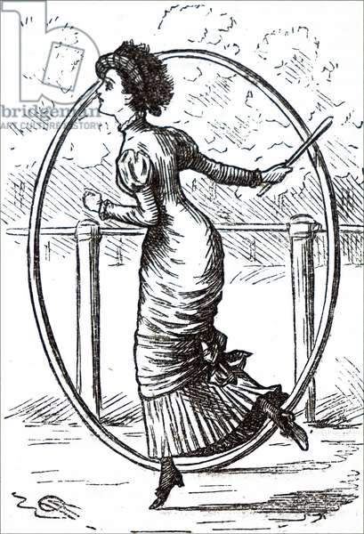 A young woman playing with a hoop