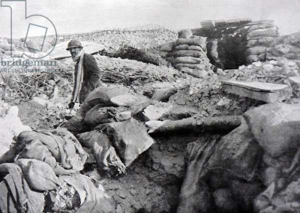 A French soldier takes a break inside his trench