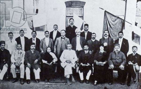 Mohandas Karamchand Gandhi and his wife Kasturba with Indian community leaders