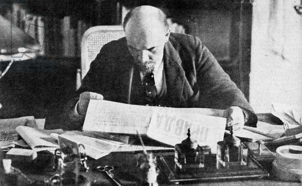 Lenin in his office in the Kremlin, reading Pravda. 1921