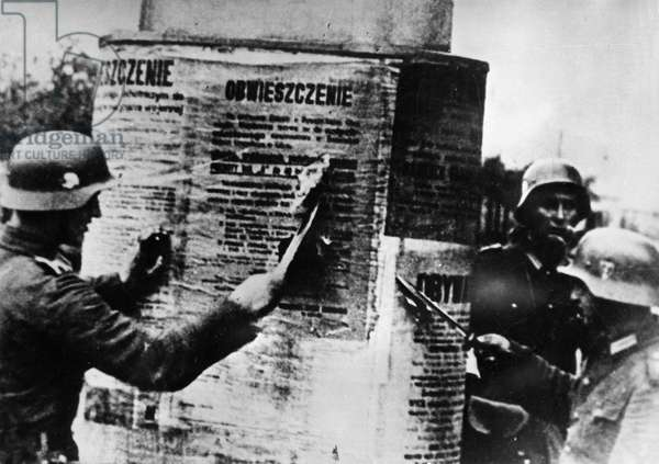 Nazi Invasion of Poland, September 1939, German Soldiers Tearing Down a Polish Proclamation, World War 2.