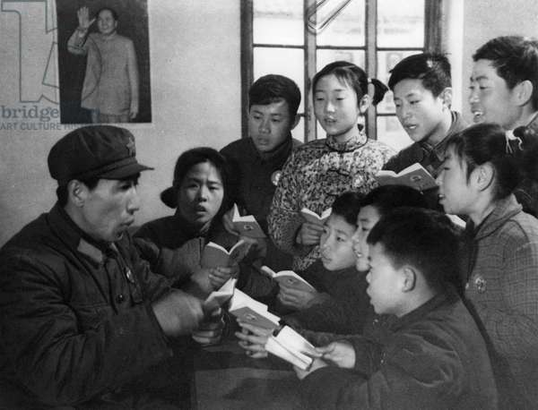 A teacher at a school for deaf mutes reads to students from 'Quotations From Chairman Mao' (the Little Red Book), People's Republic of China, 1969