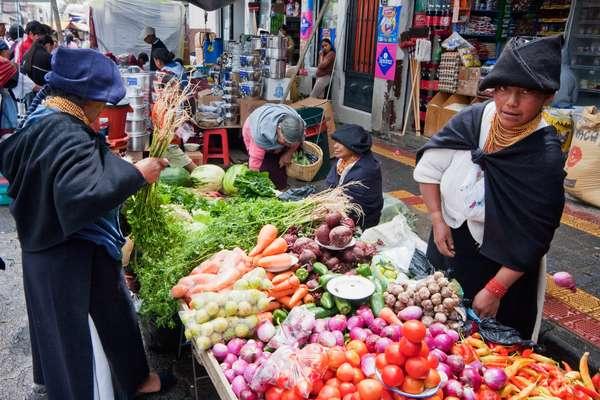 Produce Vendor at the Saturday Market, Otavalo, Imbabura, Ecuador (photo)