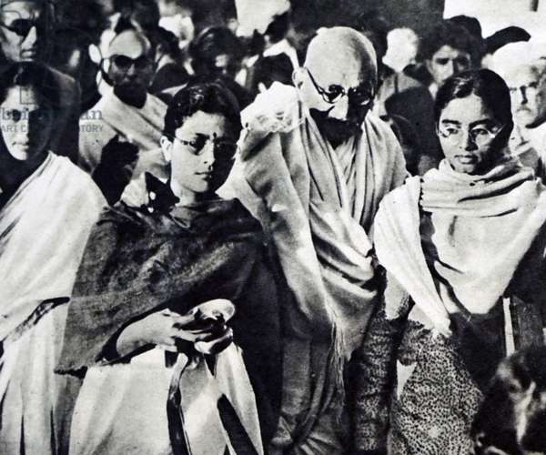 Mahatma Gandhi being supported by his Granddaughters