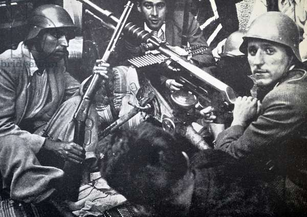 Republican fighters shelter behind a barricade during the Spanish civil war 1937