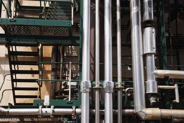 Scotland, Morayshire, Rothes, Glen Grant Scotch Whisky Distillery, pipes and staircase, close-up