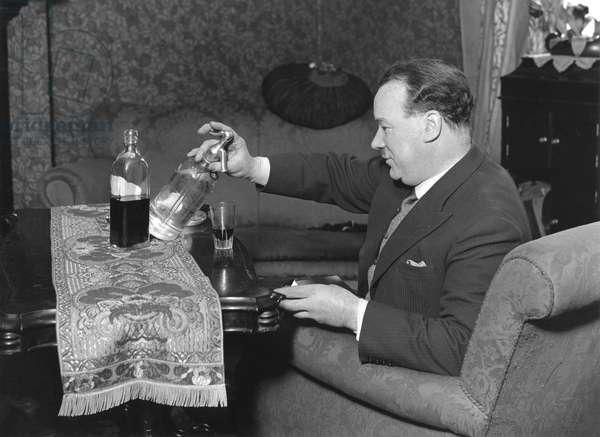 Man siphoning soda into whiskey, 23 April 1931