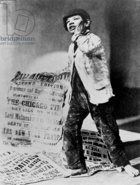 Newspaper boy with placard, 1871