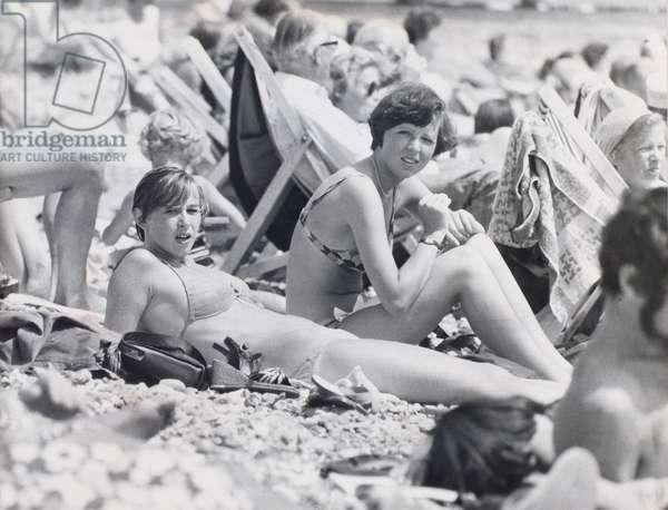 Young women sunbathing on Eastbourne beach, July 1976
