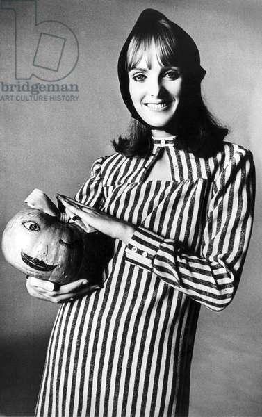 Model holding a pumpkin for Halloween, 30 October 1964