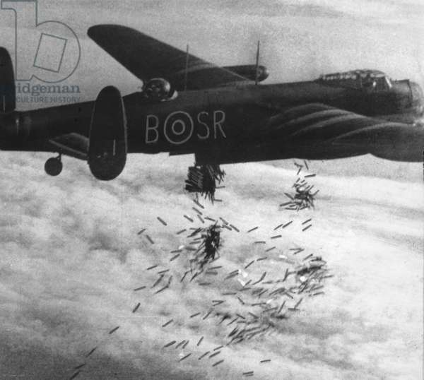 RAF (Royal Air Plane) plane dropping bombs over Duisburg, Germany, 15 October 1944