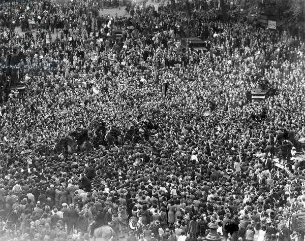Crowds mob Churchill on his way to the House of Commons, 8 May 1945