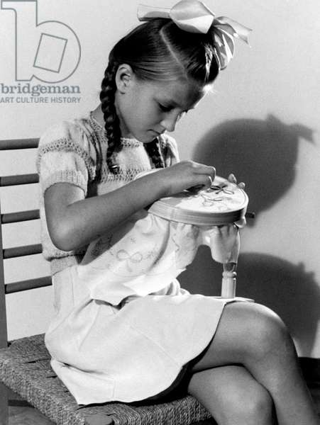 Little Girl Embroidering, 1949 (b/w photo)