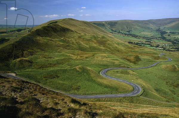 A view of Rushup Edge from Mam Tor in the Peak District with a road winding at the bottom of the hill (photo)