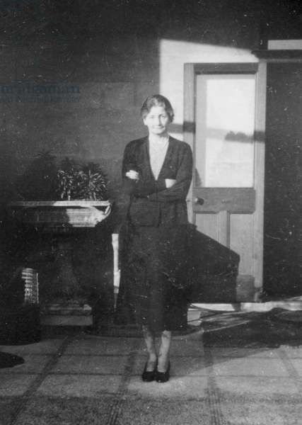 Mrs Edith Pretty, the owner of Sutton Hoo estate, standing on the veranda of Tranmer House (b/w photo)