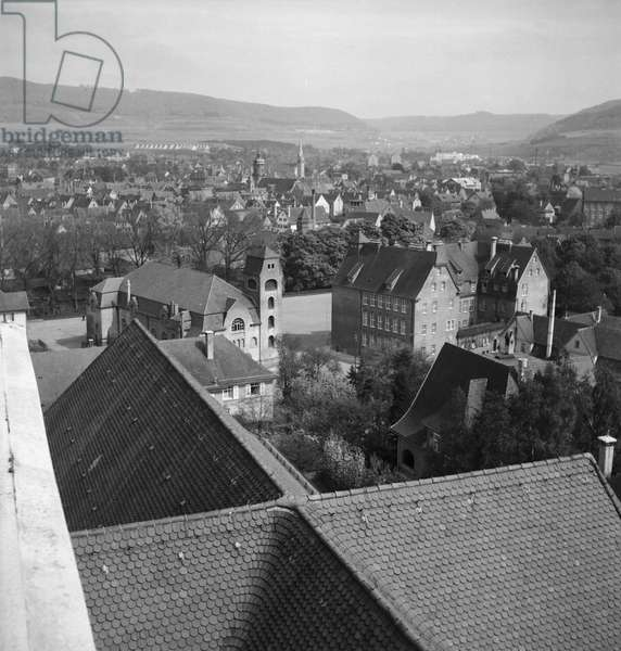 On the way through German landscape and small town, Germany 1930s (b/w photo)