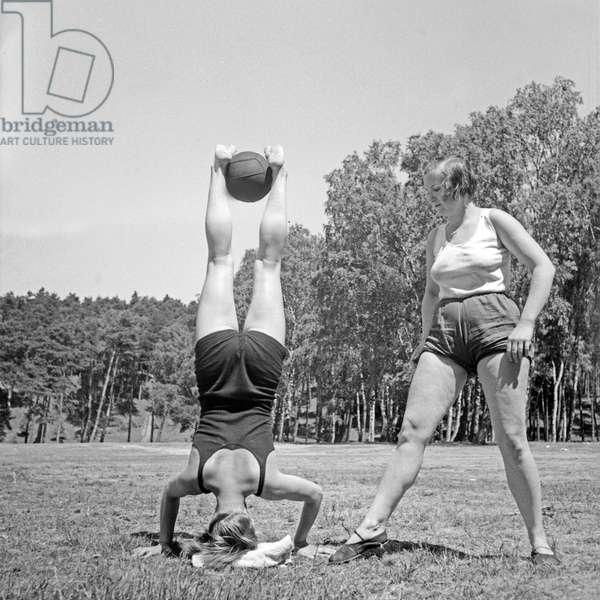 Gymnastics and ability are trained at the leisure camp of Deutsche Arbeitsfront at Altenhof, Brandenburg, 1930s (b/w photo)