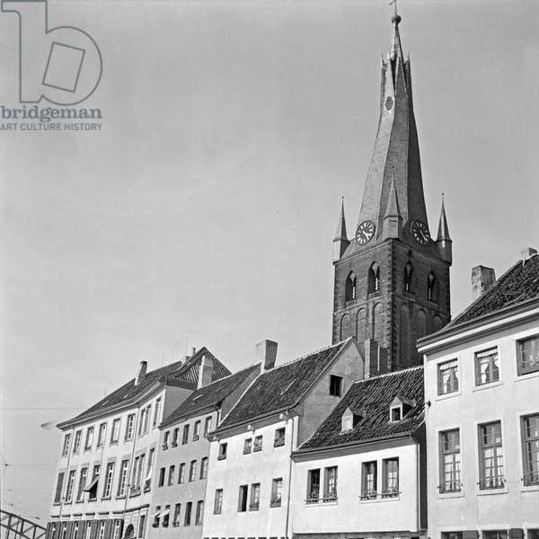 Belfry of Roman Catholic St Lambert's church over the roofs of the old city of Duesseldorf, Germany 1930s (b/w photo)