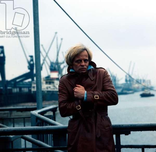 German actor Klaus Kinski at a photocall at Hamburg harbor, March 1975