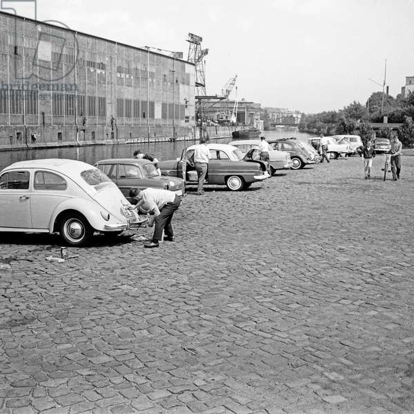 Men cleaning their cars on a Saturday at a canal in Hamburg, Germany 1960s