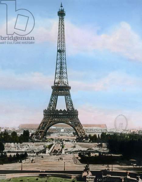 France, view to the Eiffel Tower ( La Tour Eiffel ) on the Champ de Mars in Paris. Gustave Eiffel designed and built the famous iron tower for the World's Fair in 1889. Image date: circa 1910. Carl Simon Archive