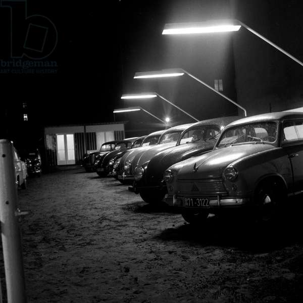 Cars at a second hand car shop by night in Hamburg 1954