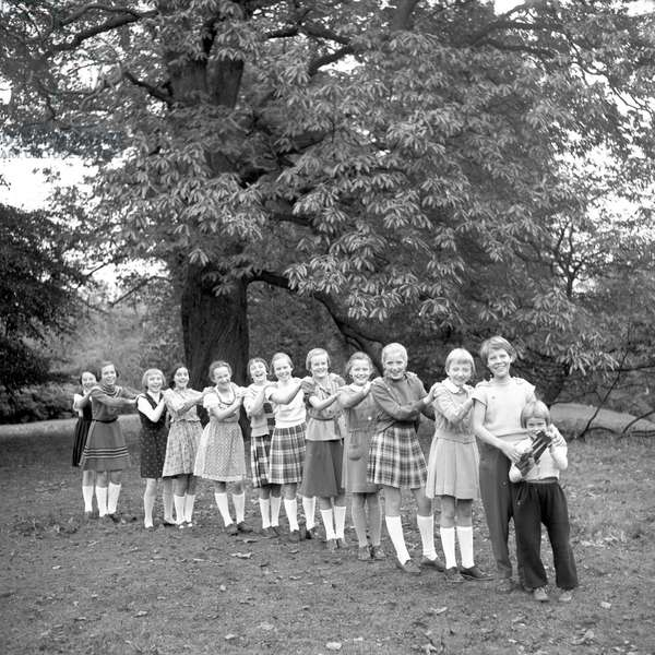 Children posing for a conga line at a park in Hamburg 1954