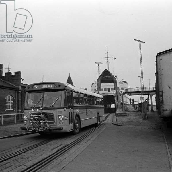 A coach leaving the ferry boar at Puttgarden harbor, Germany 1960s