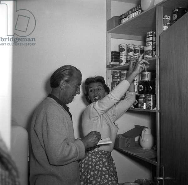 German singer and actress Lale Andersen checking the supplies with her husband Artur Beul at her house, called Sonnenhof, on the East Frisian island Langeoog, mid 1957