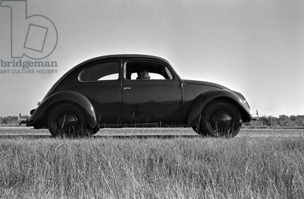 The Volkswagen beetle, or KdF car, on the test track near Wolfsburg, Germany 1930s (b/w photo)