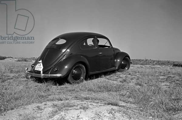 Rear end of the Volkswagen beetle, or KdF car, on the test track near Wolfsburg, Germany 1930s (b/w photo)