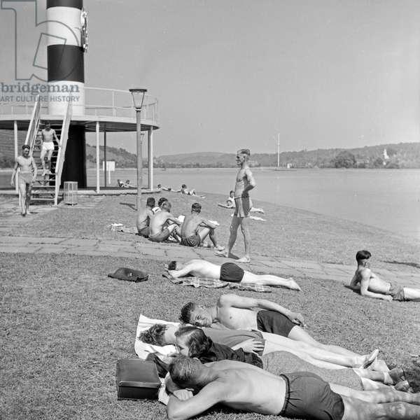 Sunbathers on the shore of Max Eyth lake at Stuttgart, Germany 1930s (b/w photo)