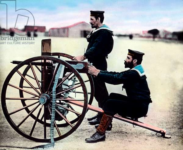 Two French soldiers exercising with machine gun at the city of Bizerta in Tunisia, c.1920