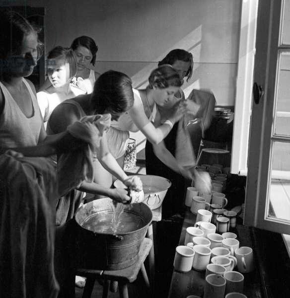 Girls doing the washing up at leisure camp of the Deutsche Arbeitsfront in Altenhof, Brandenburg, 1930s (b/w photo)