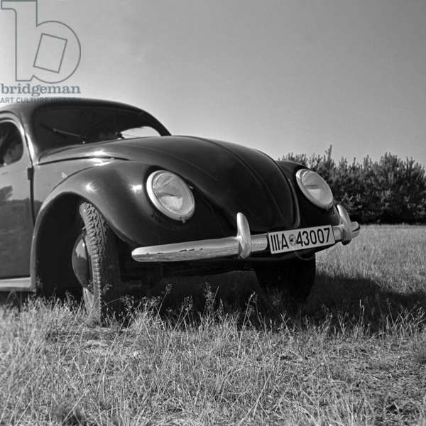 Front view of the Volkswagen beetle, or KdF car, on the test track near Wolfsburg, Germany 1930s (b/w photo)