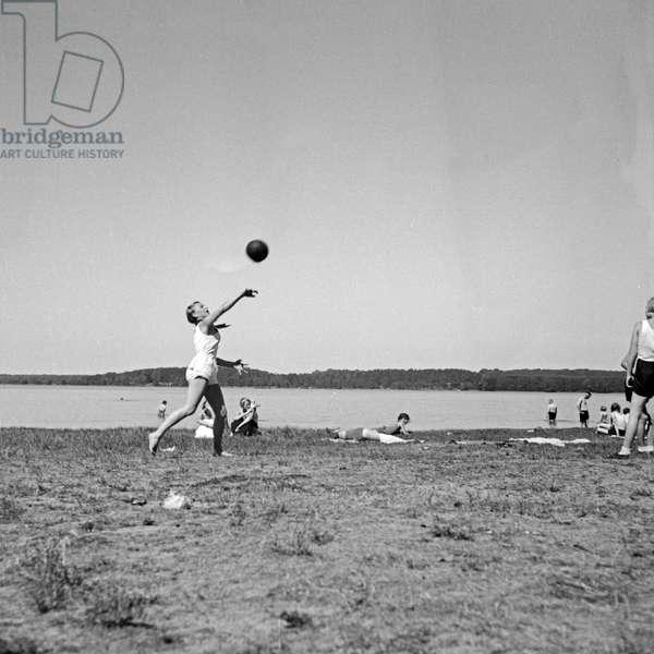 Girls playing with a ball at leisure camp of Deutsche Arbeitsfront in Altenhof, Brandenburg, 1930s (b/w photo)