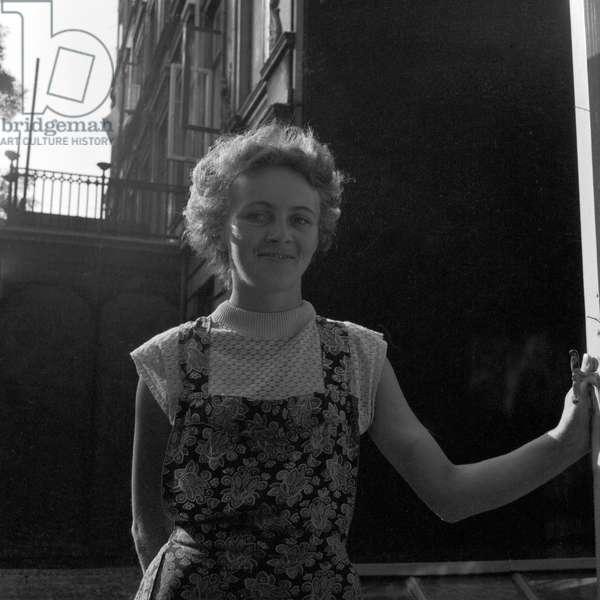 A young woman in a backyard in Hamburg 1955