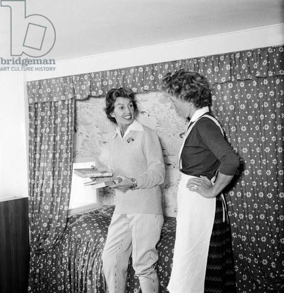 German singer and actress Lale Andersen and her housekeeper at her house, called Sonnenhof, on the East Frisian island Langeoog, mid 1957