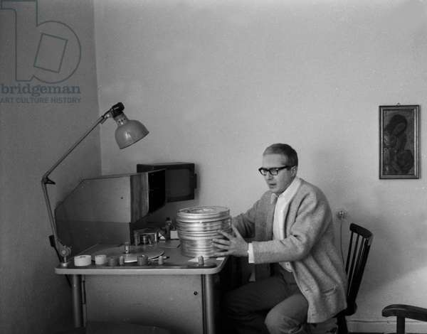 German actor Werner Bruhns, husband of journalist and author Wibke Bruhns with film reels at his cutting desk, end 1960s