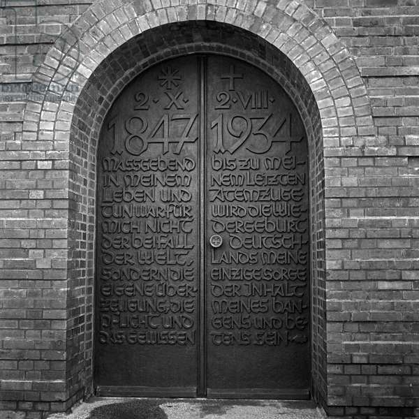 Entrance to the tomb with a quote of Paul von Hindenburg at the inner courtyard at the Tannenberg monument near Hohenstein in East Prussia, Germany 1930s (b/w photo)