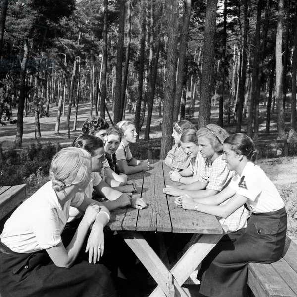 A group of BDM girls sitting in the sun at leisure camp of Deutsche Arbeitsfront at Altenhof, Brandenburg, 1930s (b/w photo)