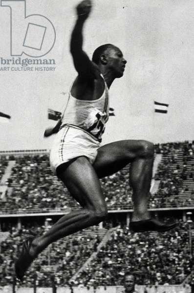1936 Olympic Games. Berlin. Mens Long Jump. JESSE OWENS, USA, Gold Medal.